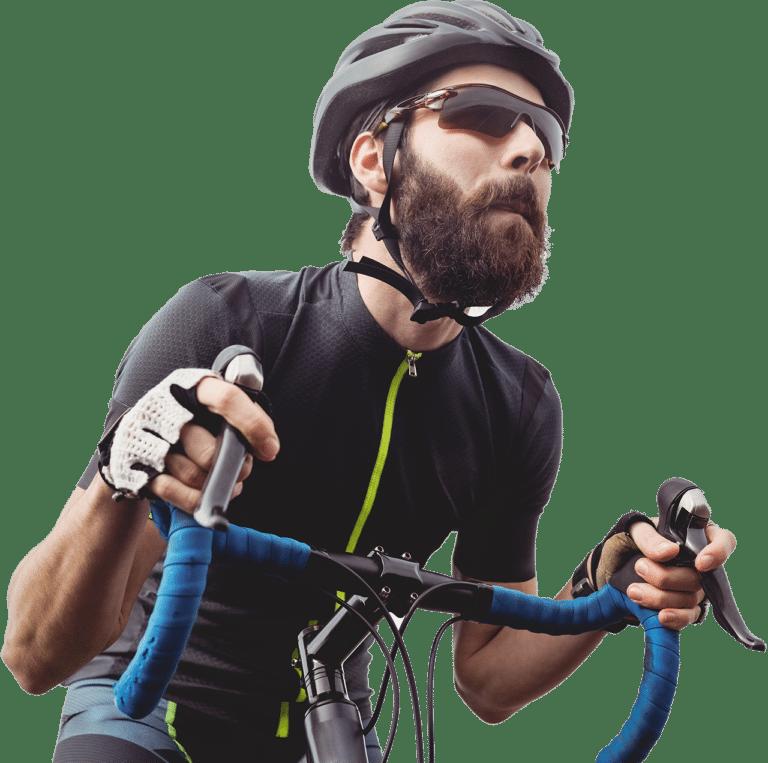 Cykelrytter på hometrainer cykel.